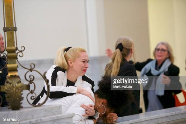 Bill Cosby accusers Caroline Heldman Lili Bernard and Victoria Valentino react after the guilty on all counts verdict was delivered in the sexual...