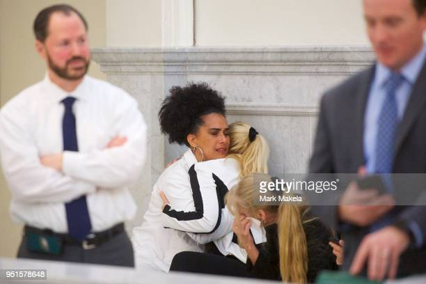 Bill Cosby accusers Lili Bernard and Caroline Heldman react after the guilty on all counts verdict was delivered in the sexual assault retrial at the...