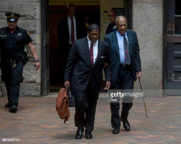 Bill Cosby and spokesman Andrew Wyatt leave the Allegheny County Courthouse May 24 2017 in Pittsburgh Pennsylvania Jury selection entered day three...
