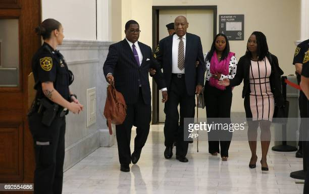 Bill Cosby arrives with Keshia Knight Pulliam who played his daughter Rudy Huxtable on 'The Cosby Show' at courtroom A inside the Montgomery County...