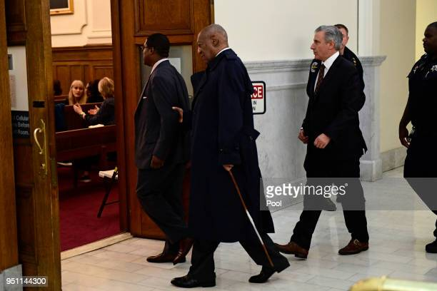 Bill Cosby center arrives for his sexual assault trial lead by spokesperson Andrew Wyatt at the Montgomery County Courthouse on April 25 in...