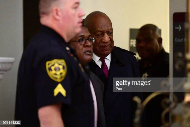 Bill Cosby center arrives for his sexual assault trial lead by spokesperson Andrew Wyatt left center at the Montgomery County Courthouse on April 25...