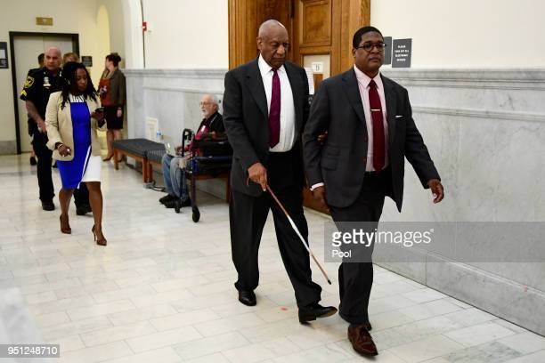 Bill Cosby center is led by spokesperson Andrew Wyatt as publicist Ebonee Benson follows during a break in his sexual assault trial at the Montgomery...