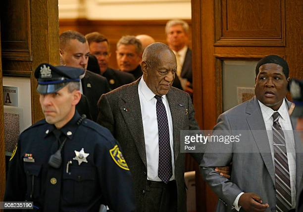 Bill Cosby center is led out of Courtroom A after the judge ruled that he would not throw out the sexual assault case against him and that it will go...