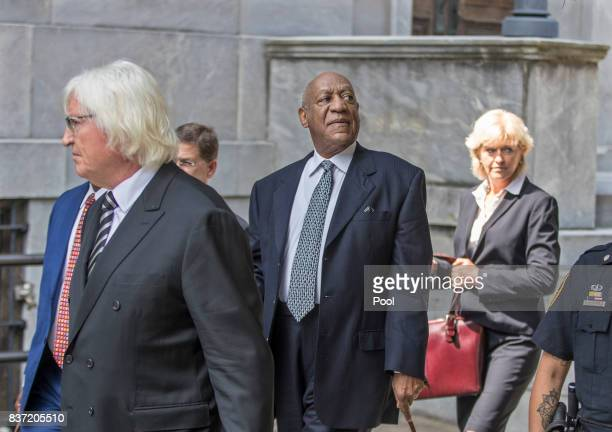 Bill Cosby center surrounded by his new legal team Tom Mesereau left and Kathleen Bliss right leans his head back to hear words of encouragement from...