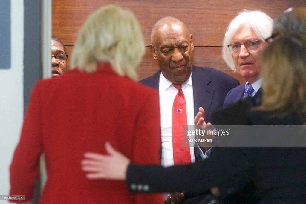 Bill Cosby (C) descends an elevator with his attorney Tom Mesereau (R) at the Montgomery County Courthouse after being found guilty on all counts in his sexual assault retrial on April 26, 2018 in Norristown, Pennsylvania. Cosby was found guilty on all accounts after a former Temple University employee alleges that the entertainer drugged and molested her in 2004 at his home in suburban Philadelphia. More than 40 women have accused the 80 year old entertainer of sexual assault.