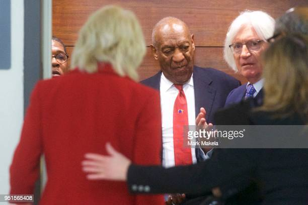 Bill Cosby descends an elevator with his attorney Tom Mesereau at the Montgomery County Courthouse after being found guilty on all counts in his...