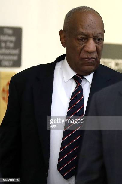 CORRECTION Bill Cosby enters the courtroom at the Montgomery County Courthouse in Norristown Pennsylvania as his assault trial continues on June 12...
