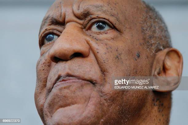 TOPSHOT Bill Cosby exits the courthouse after a mistrial on the sixth day of jury deliberations of his sexual assault trial at the Montgomery County...