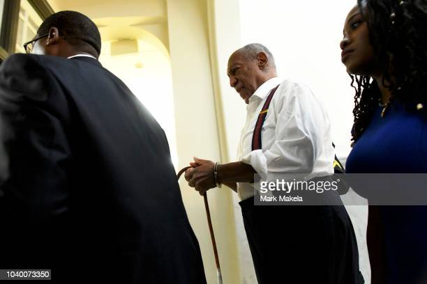 Bill Cosby is taken away in handcuffs after being sentenced to 310 years in his sexual assault retrial at the Montgomery County Courthouse on...