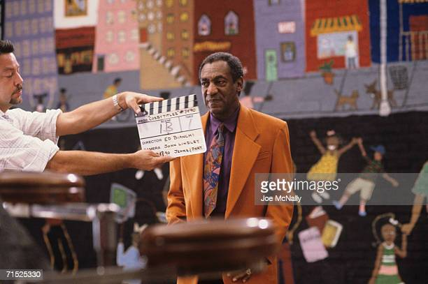 Bill Cosby prepares to film the new opening sequence for The Cosby Show's seventh season at Kaufman-Astoria Studios in New York in August, 1990.