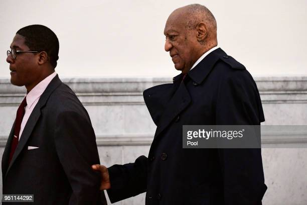 Bill Cosby right arrives for his sexual assault trial lead by spokesperson Andrew Wyatt at the Montgomery County Courthouse on April 25 in Norristown...