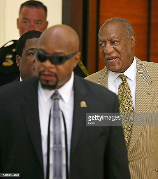 Bill Cosby right is surrounded by members of his security team as he walks to Courtroom A in the Montgomery County Courthouse on July 7 2016 in...