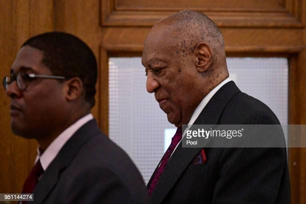 Bill Cosby right walks back to courtroom A after a break shortly after arriving for his sexual assault trial lead by spokesperson Andrew Wyatt at the...