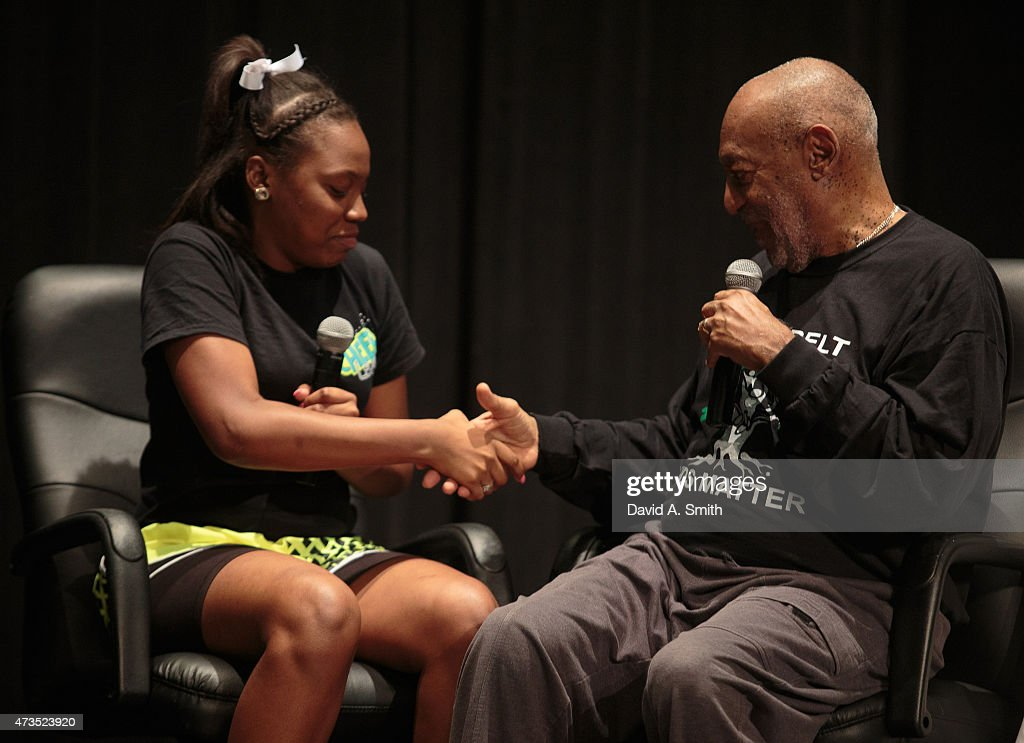 Bill Cosby speaks with a student at Selma High School as part of the Black Belt Community Foundation's March for Education on May 15, 2015 in Selma, Alabama.
