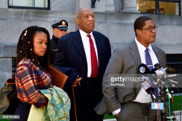 Bill Cosby stands behind Rennee Benson and Andrew Wyatt as his spokesperson delivers a statement to the press upon depart after day 10 of the sexual...
