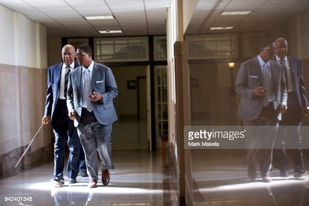 Bill Cosby walks through the Montgomery County Courthouse during jury selection for his sexual assault retrial April 5 2018 in Norristown...