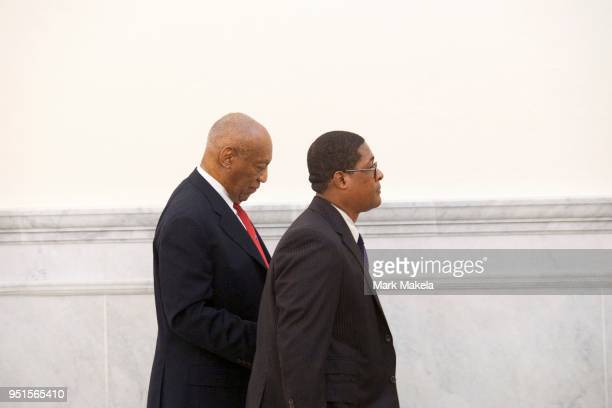 Bill Cosby walks through the Montgomery County Courthouse with his publicist, Andrew Wyatt, after being found guilty on all counts in his sexual...