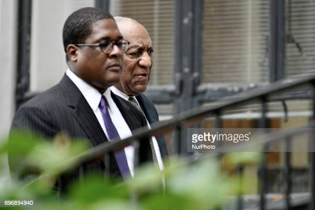 Bill Cosby with spokesperson Andrew Wyatt walks in upon arrival for the sixth day of deliberations the aggravated indecent assault trail of the jury...