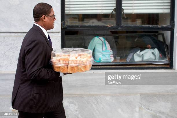 Bill Cosby's spokesperson Andrew Wyatt caries lunch during a March 29 2018 pretrial hearing at Montgomery County Courthouse in Norristown PA After...