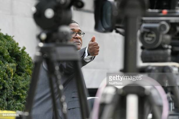 Bill Cosby's spokesperson Andrew Wyatt walks past cameras outside Montgomery County Courthouse in Norristown PA on April 9 2018 as the sexual assault...