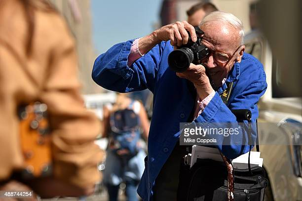 Bill Cunningham photographs guests leaving Ralph Lauren Spring 2016 during New York Fashion Week The Shows at Skylight Clarkson Sq on September 17...