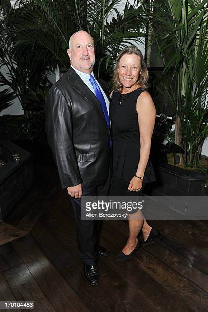 Bill Curtis and wife Lisa Curtis attend Jeremy Renner's and Kristoffer Winters' celebration of the launch of Robb Report Home Style on June 6 2013 in...