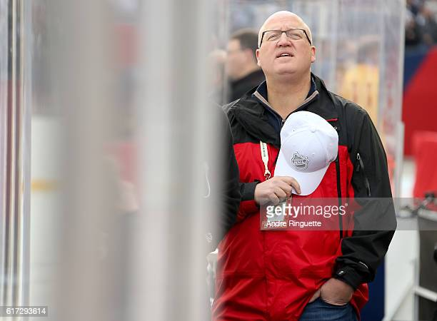 Bill Daly stands for the Canadian national anthem during the 2016 Tim Hortons NHL Heritage Classic alumni game at Investors Group Field on October 22...