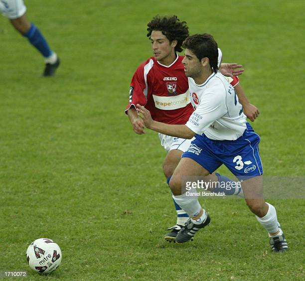Bill Damianis of South Melbourne is challenged by Anthony Doumanis of United for the ball during the NSL round 16 match between Sydney United and...