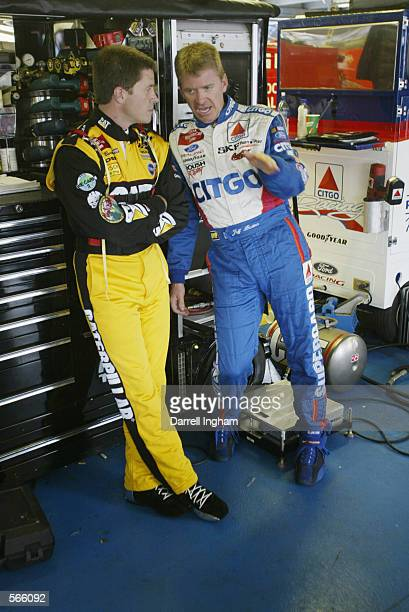 Bill Davis Racing Dodge Intrepid R/T driver Ward Burton listens to his brother Jeff driver of the CITGO Fordduring practice for The Winston NASCAR...
