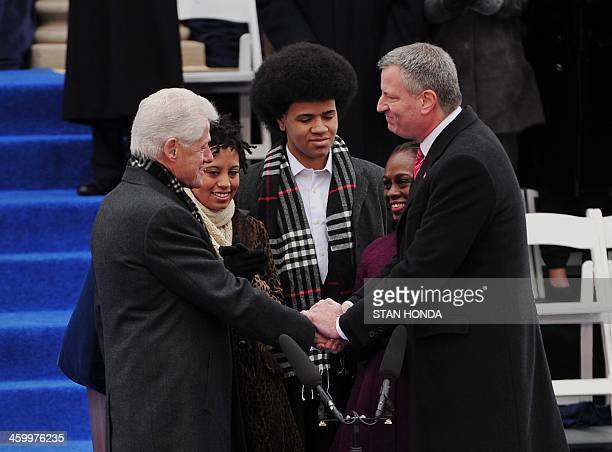 Bill de Blasio after being sworn in as New York City Mayor by former US President Bill Clinton shakes hands on the steps of City Hall in Lower...