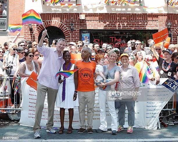 Bill de Blasio, Chirlane McCray, Al Sharpton, Cynthia Nixon, Max Ellington Nixon-Marinoni, and Christine Marinoni participate in the 2016 Pride March...