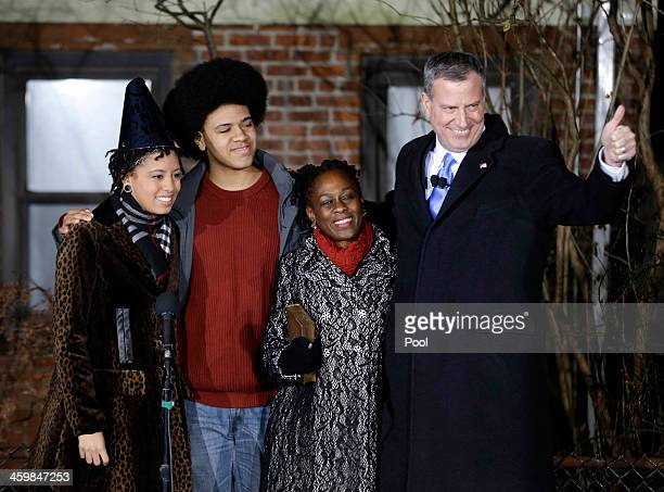 Bill de Blasio gives the thumbs up whilst standing with his family Chiara de Blasio Dante de Blasio and wife Chirlane McCray after being sworn in as...