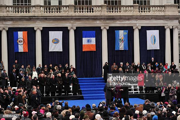 Bill de Blasio is sworn in as New York City Mayor by former US President Bill Clinton on the steps of City Hall in Lower Manhattan January 1 2014 in...