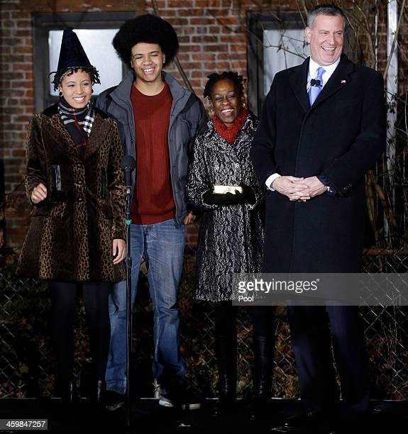 Bill de Blasio laughs his with family Chiara de Blasio Dante de Blasio and wife Chirlane McCray before being sworn in as mayor of New York City after...