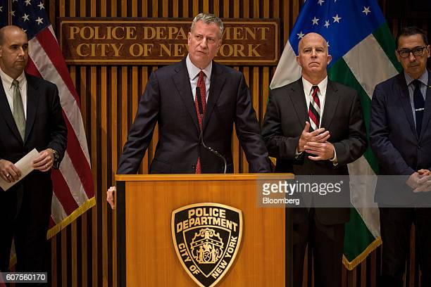 Bill de Blasio mayor of New York City speaks as Bill Sweeney assistant director of the Federal Bureau of Investigation left and James O'Neill police...