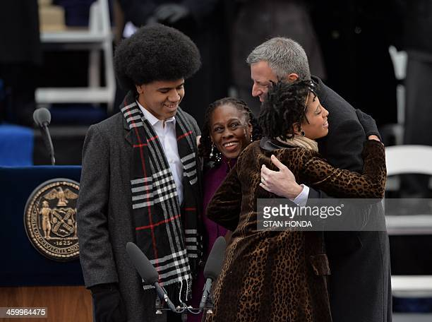 Bill de Blasio reacts after being sworn in as New York City Mayor on the steps of City Hall in Lower Manhattan January 1 2014 in New York with his...