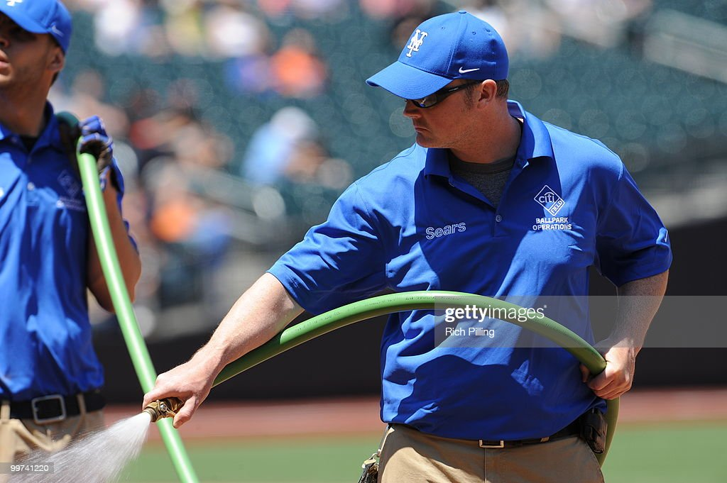 Bill Deacon, head grounds keeper of the New York Mets waters the infiled prior to the extra inning game against the San Francisco Giants at Citi Field in Flushing, New York on May 8, 2010. The Mets defeated the Gaints 5-4 in 11 innings.