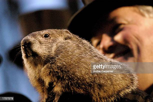 Bill Deeley presents Punxsutawney Phil to the crowd at Gobbler's Knob during the annual Groundhog day event February 2 2003 in Punxsutawney...