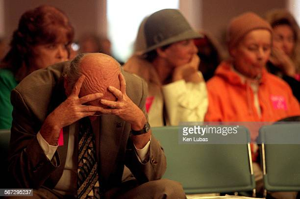Bill Dyer of In Defense of Animals cradles his head as an opponent of athe proposed mandatory spay/neuter regulation for dogs and cats is discussed...