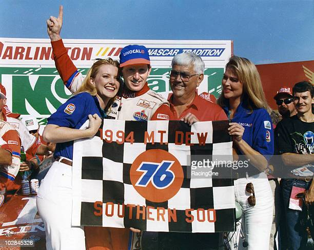 Bill Elliott and car owner Junior Johnson celebrate their win in the Mountain Dew Southern 500 NASCAR Cup race at Darlington Raceway