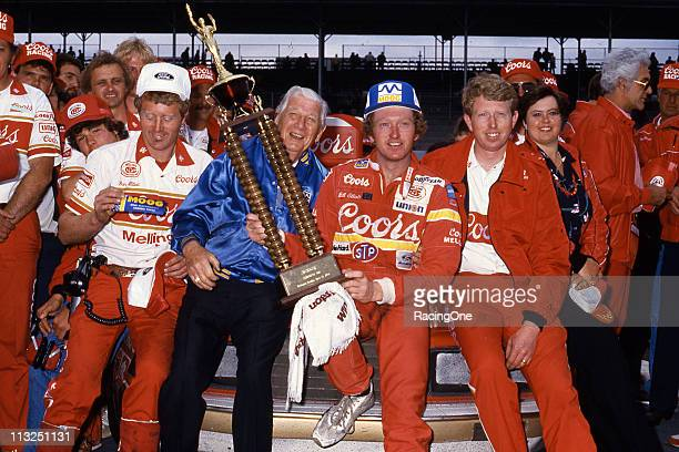 Bill Elliott celebrates with his Coors/Melling crew after scoring a victory in the TranSouth Financial 500 NASCAR Cup race at Darlington Raceway...