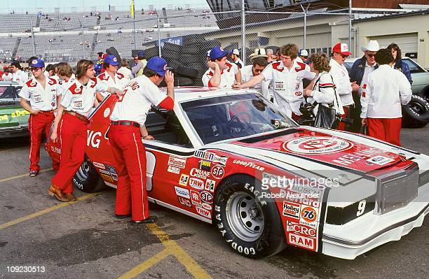 Bill Elliott driver of the Melling Ford talks with a photographer while he and his crew wait their turn to be inspected at Daytona International...