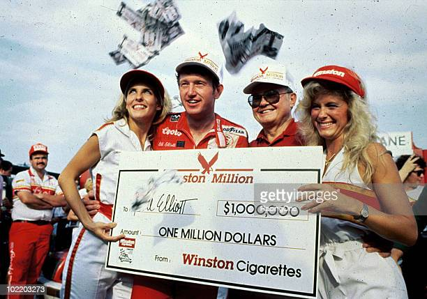 Bill Elliott enjoys the spoils of winning the ÒWinston MillionÓ after his victory in the Southern 500 at Darlington Raceway His triple crown included...