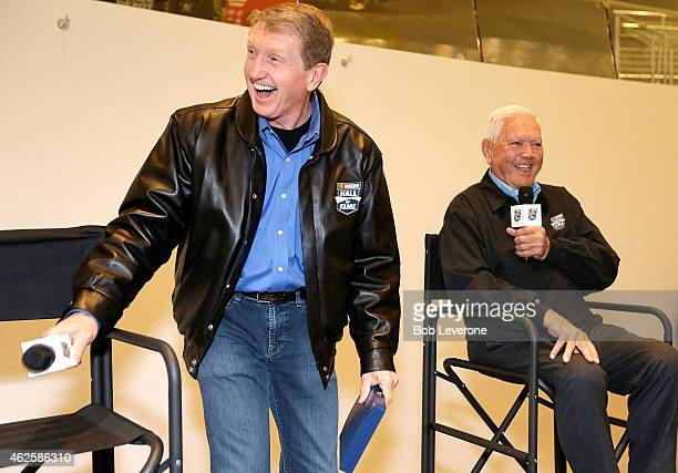 Bill Elliott newly inducted into the NASCAR Hall of Fame left jokes with fellow hall member Junior Johnson during NASCAR's Fan Appreciation Day at...