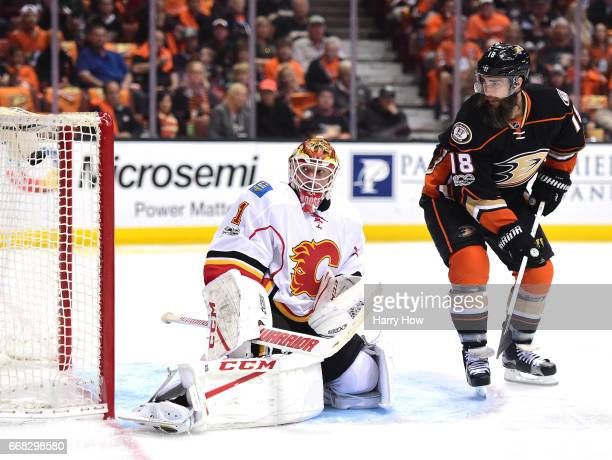 Bill Elliott of the Calgary Flames and Patrick Eaves of the Anaheim Ducks react to a goal from Ryan Getzlaf to take a 10 lead during the first period...