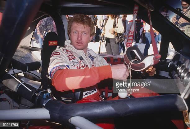 Bill Elliott prepares to drive in his car before the Atlanta Journal 500 at the Atlanta Motor Speedway on November 20, 1988 in Atlanta, Georgia. The...