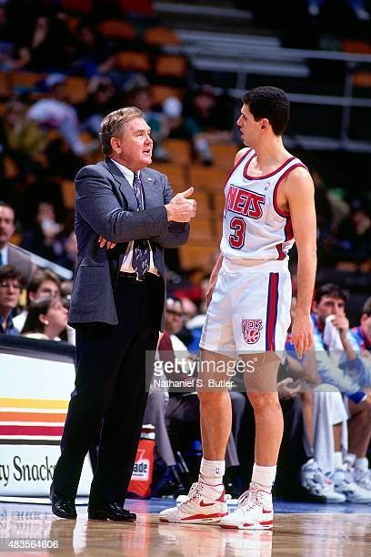 Bill Fitch and Drazen Petrovic of the New Jersey Nets speak during a game circa 1991 at Brendan Byrne Arena in East Rutherford NJ NOTE TO USER User...