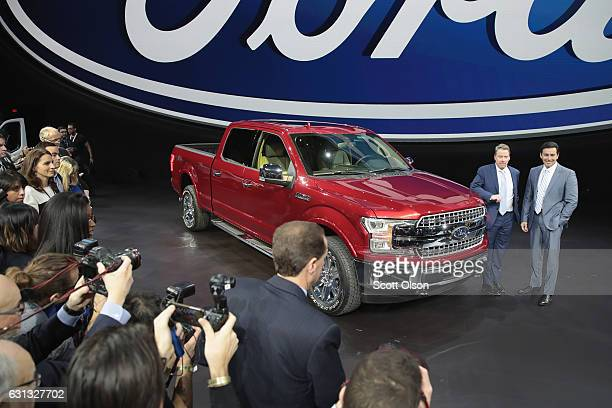 Bill Ford Executive Chairman of Ford and Mark Fields President and CEO show off Ford's new F150 at the North American International Auto Show on...
