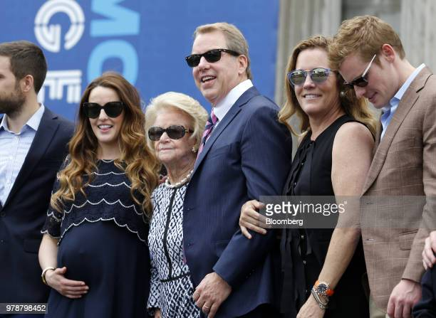 Bill Ford executive chairman of Ford Motor Co center stands for a photograph with his mother Martha Firestone Ford majority owner of the Detroit...